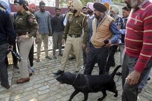 Police inspect the site of blast at the Nirankari Bhawan, where two men on a motorcycle threw a grenade during a religious congregation, in Adliwal village near Amritsar, Punjab, Sunday, Nov 18, 2018.