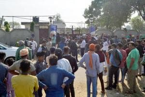Police personnel and people seen outside the Nirankari Bhawan after two men on a motorcycle reportedly threw a grenade at the Nirankari Bhawan during a religious congregation, at Adliwal village, near Rajasansi, Amritsar, India, on Sunday, November 18, 2018.