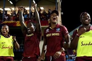 Windies players celebrate after winning a thriller against England.