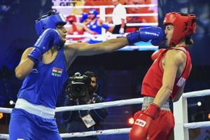 India's Sonia Chahal (in blue) punches Stanimira Petrova of Bulgaria during the women