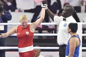Poland`s Elzbieta Wojcik (in Red) reacts after her victory against Saweety Boora (in Blue) in Women