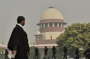 Representational image of a man walks in front of the Supreme Court in New Delhi