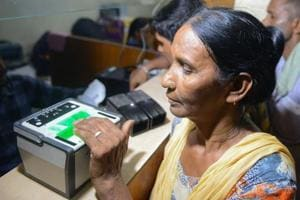 This photo taken on July 17, 2018 shows an Indian woman getting her fingerprints read during the registration process for Aadhaar cards