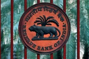 Reserve Bank of India logo is seen at the gate of its office in New Delhi.