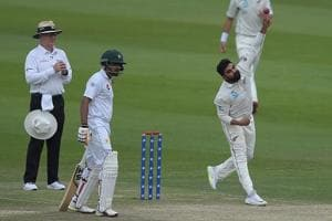New Zealand spinner Ajaz Patel (R) delivers the ball as Pakistani batsman Babar Azam looks on during the second day of the first Test cricket match between Pakistan and New Zealand at the Sheikh Zayed International Cricket Stadium in Abu Dhabi.