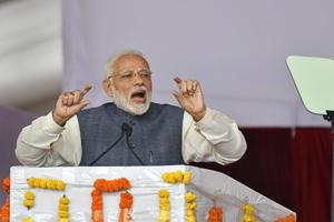 Prime Minister Narendra Modi gestures as he addresses a public meeting during
