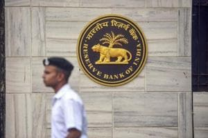 A security person walks past the RBI Headquarters in Mumbai on November 19.