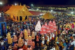In this file photo dated December 24, 2014, a 'Karppoorazhi' procession is being taken out at Lord Ayyappa temple, in Sabarimala.