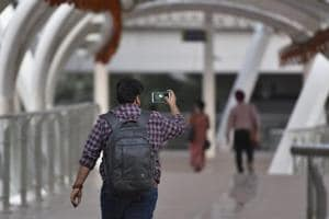 A youngster clicks selfie at the Skywalk at ITO, in New Delhi.