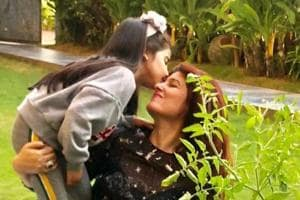 Twinkle Khanna gets a kiss from daughter Nitara.
