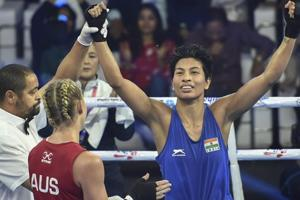 Indian boxer Lovlina Borgohain reacts after defeating Australia's Kaye Scott in the quarterfinals at AIBA Women