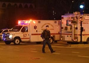 A Chicago police officer works the scene after a gunman opened fire at Mercy Hospital on Monday, Nov. 19, 2018, in Chicago. A police spokesman said the gunman was dead, but it was not immediately clear if he took his own life or was killed by police at the hospital on the city