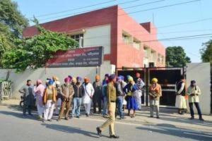 Members of Guru Granth Sahib Satkar committee gathered outside the office of IG Border range SPS Parmar near Kitchlew chowk to meet him regarding detention of their colloquies in connection with grenade attack at Nirankari Bhawan in Amritsar on Tuesday, November 20, 2018.