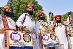 Rajasthani artists display their moustache during an election awareness campaign, in Bikaner, Thursday, Nov. 15, 2018.  A couple has filed their nomination as independent candidates from Bikaner East seat.