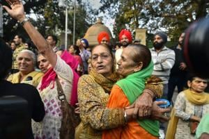 Family members of the victims of 1984 anti-Sikh riots celebrate outside the Patiala House Court in New Delhi, Tuesday, Nov 20, 2018, after the pronouncement of the first death punishment in the case.