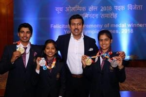 Minister of State for Youth Affairs & Sports, Rajyavardhan Singh Rathore with shooters Saurabh Chaudhury, Mehuli Ghosh, and Manu Bhaker during the winners of the Summer Youth Olympics 2018 felicitation ceremony, in New Delhi