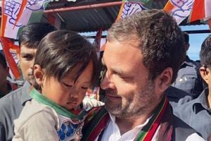 Champhai: Congress President Rahul Gandhi holds a child during an election rally in Champai, Mizoram, Tuesday, Nov 20, 2018. (PTI Photo) (PTI11_20_2018_000083B)
