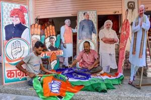 Workers prepare promotional materials for BJP and Congress ahead of the Rajasthan Assembly Elections, at Tripolia Bazaar in Jaipur on November 14.