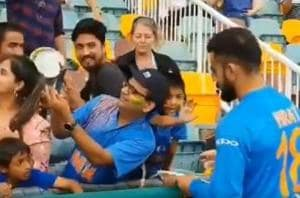 Screengrab of a video posted by BCCI of Indian captain Virat Kohli signing autographs for fans at the Gabba in Brisbane.