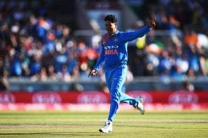 Kuldeep Yadav celebrates after picking up a wicket.