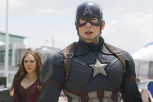 This image released by Disney shows Elizabeth Olsen, left, and Chris Evans in a scene from Marvel