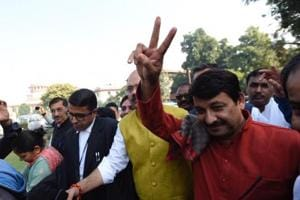 Delhi BJP president Manoj Tiwari shows victory sign after he was acquitted in a sealing case by the Supreme Court.