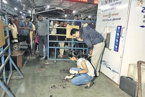 Forensic experts gather evidence from platform number 3 of the Pune railway station where inspector Gajanan Pawar was shot at on Wednesday evening.