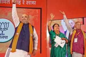 BJP President Amit Shah, Rajasthan Chief Minister Vasundhara Raje and State President Madan Lal Saini during  a party event in Jaipur, Wednesday, Nov. 21, 2018.
