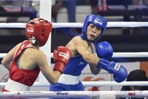 New Delhi, India - Nov. 18, 2018: Boxer Mary Kom (in Blue) in a bout against Kazakhstan