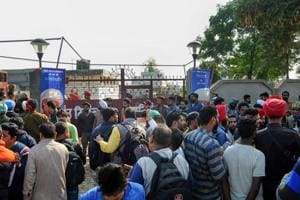 Amritsar: People gather at the Nirankari Bhawan, where two men on a motorcycle reportedly threw a grenade during a religious congregation, in Adliwal village near Amritsar, Punjab, Sunday, Nov 18, 2018.