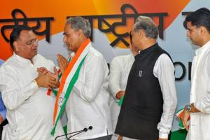 Congres general secretary and Rajasthan state party incharge Avinash Pande (left) welcomes Dausa BJP MP Harish Chandra Meena (2nd L) as he joins the party, at AICC headquarter in New Delhi, Wednesday, Nov 14, 2018. Rajasthan Congress chief Sachin Pilot and senior leader Ashok Gehlot are also seen.