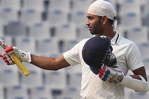 Milind Kumar reacting after he completed his century against Odisha.