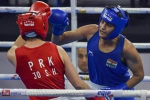 Sonia Chahal (in blue) punches her North Korean opponent Jo Son Hwa during their semifinal match.