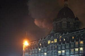 Fire and smoke is seen during an attack at the Taj Mahal Palace hotel in Mumbai on November 26, 2008.