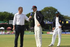 England captain Joe Root speaks to Michael Atherton after winning the toss again before Day One of the Third Test match between Sri Lanka and England.