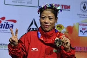 Mary Kom of India gestures with her gold medal after winning the 45-48 kg category final fight at the 2018 AIBA Women