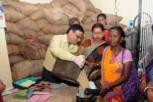 Public purchasing food grain distributed through PDS shop by the new ration card issued by the state government in Ranchi