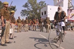 Police stand guard to tighten the security as thousands of Shiv Sena activists will take part in Dharm Sabha, in Ayodhya on November 24