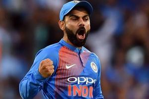 Virat Kohli celebrates the dismissal of Australia