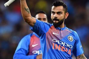 Virat Kohli celebrates his team