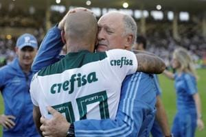 Palmeiras coach Luiz Felipe Scolari celebrates with Felipe Melo after winning the Brasileiro Championship title.