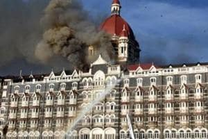 26/11 - Mumbai Under Terror Attack - Firing - Fire at Taj Hotel - Fire brigade officers fighting with fire at Taj hotel.