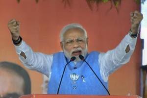 Vidisha: Prime Minister Narendra Modi addresses a public meeting for Madhya Pradesh Assembly elections campaign, in Vidisha, Sunday, Nov. 25, 2018. (PTI Photo) (PTI11_25_2018_000181A)