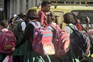 School going students carrying heavy school bags in Pune.