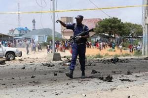 A Somalia police officer secures the scene of a suicide bomb attack. (Representational Photo)