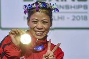 New Delhi: Indian boxer Mary Kom poses with her gold medal after winning the final match of women