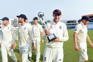 England cricket team captain Joe Root (C) poses with the winner