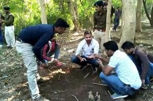 Police and forensic team recover bones of a five-year-old girl, who was allegedly raped and killed on September 23, 2013, from Kampu area in Gwalior, Madhya Pradesh on Saturday, November 24, 2018.