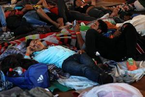 Migrants, part of a caravan of thousands from Central America trying to reach the United States, resting under a tent at a temporary shelter in Tijuana, Mexico.