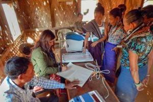 Electoral officials demonstrate how to use an Electronic Voting Machine (EVM) at Kasko Reang refugee camp, in Panisagar sub-division of Mizoram Sunday, Nov. 25, 2018.  Assembly election in Mizroram is slated for November 28, 2018.